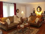 Living Room with plenty of comfortable seating, gas log fireplace, massage chair.