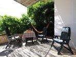 Front terrace has a small veranda that provides shade
