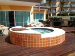 Large unique roman hot tub on private deck with full-size BBQ grill!