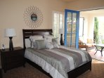 Queen bedroom with private patio, fireplace, flat screen TV, Apple TV,  and wet bar with refigerator