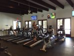 Brand new exercise room with new machines, free weights, and equipment.