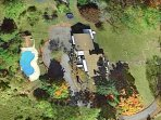 Ariel view of house, pool & property. Beautiful in the fall.