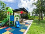 Village lawn equipped with a covered gazebo, benches and a kid's playground