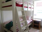 This charming bunk room is on the ground floor