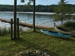 Fire Pit, Canoe at Lake shore, another canoe alongside attached garage.