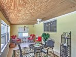 Ceiling fans and inviting patio furniture ensure the utmost comfort.