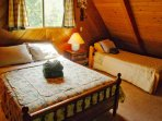 Loft with one queen bed and two twin beds