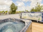 Hydro therapy hot tub located on the amazing roof terrace of Neptune Lodge