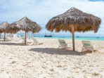 Private beach with personal loungers and parasol