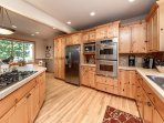 Spacious Kitchen with stainless steel appliances, double oven, wine chiller