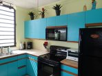 A colorful and tropical kitchen