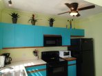 A colorful and tropical fully equipped kitchen