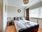 Master double bedroom with a glimpse of sea! Beds made up for guests arrival