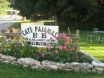 side lawn and more flowers surround our sign