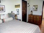 The northeast bedroom sleeps two in a cozy room.