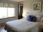 The northwest master bedroom has a queen size bed.