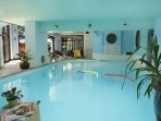 Indoor pool at the hotel next door which is available for use by the apartment