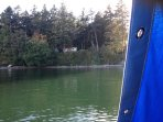 Here is our cove.  Cabin to L in trees, camping unit to R. Private 200' beach. Such a treasure