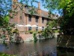 Tudor barn restaurant and bar with a ,moat