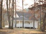 The White Farmhouse after a light snow.  Cottage Rental near Mena, Arkansas