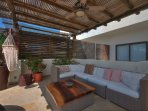 shaded outdoor living patio at pool levle