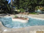 25 person hot tub and across on your right is a heated pool for cooler months!