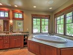 Enjoy a relaxing soak in the  master bathroom's alluring tub.
