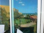 Reflection of your Ocean View in the balcony glass-door!