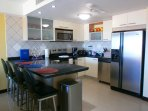 Full-size fully equipped kitchen with 4-seat breakfast bar.