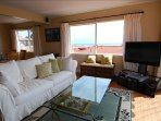 Comfortable living room with sit-down pier view - pull out queen size sofa bed