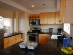 Remodeled kitchen with stainless steel appliances and real fossil countertop