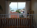 Look out to the Strands beach at Dana Point from the comfort of full size futon