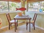 Enjoy breakfast or coffee in the charming sunroom