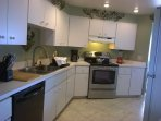 Triangular kitchen, many cabinets here