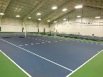 indoor tennis court located at clubhouse