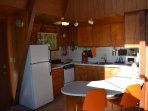 Studio kitchen with fridge, stove, microwave, coffee, toaster, blender
