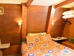 Queen bed in lower bedroom
