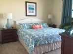 Spacious and relaxing Master Bedroom with access to patio and an ocean view!