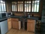 Hilltop House Kitchen, Sink, Fridge/Freezer, Microwave and Countertop Oven, Induction Burner