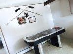 The home has an air hockey table and fooseball table for your entertainment.