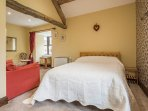 The double bedroom has an oak beamed ceiling,