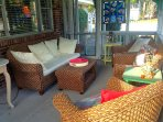 Screened porch is perfect for long chats and board games.