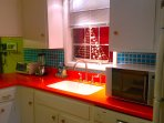 Kitchen with colorful corian countertops