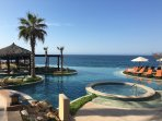 Enjoy every moment of your vacation relaxing by the infinity pool.
