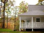 The White Farmhouse Cottage in fall.  Near Mena Arkansas.  Scenic Mountain views.