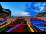 Colourful fishing boats on Praia do Carvoeiro.