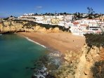 Gorgeous winter sun shines on the village and beach of Praia do Carvoeiro.