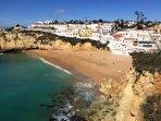 Gorgeous winter sun shines on the village and beach of Praia do Carvoeiro.