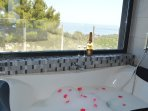 En-suite bathroom with double bath from where you have a lovely sea view
