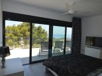 Sliding doors from the master bedroom toa large terrace with sea view